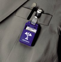 Neutron badge pinned to a person's coat pocket (chest high)