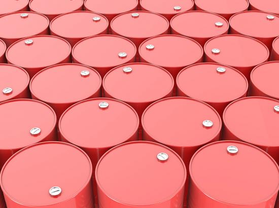 Large group of red drums stacked tightly next to one another.